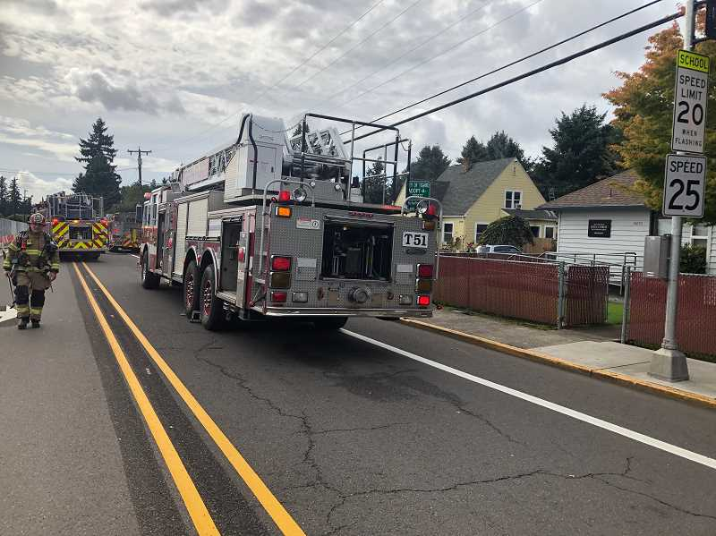 COURTESY TVF&R - A Washington County Sheriffs duputy and off-duty fire captain used a garden hose to help put down flames at a Tigard home on Monday.