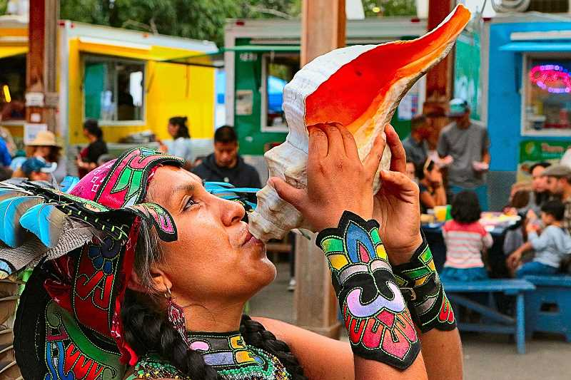 DAVID F. ASHTON - Signaling the start of this years Taste of LatinoamÉrica fiesta by sounding a conch shell was a performer with Huehca Omeyocan Aztec Dance.