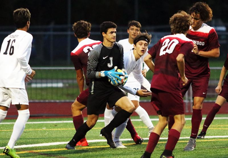 PMG PHOTO: DAN BROOD - Jesuit High School senior goalkeeper Nolan Gregg grabs the ball in a crowd during the Crusaders' 1-0 win at Sherwood.