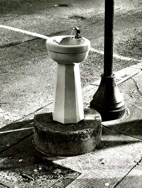 COURTESY OF SMILE HISTORY COMMITTEE - And heres a close-up of the same porcelain water fountain shown in the earlier wide photo. This photo was taken over 30 years later, in 1968; this fountain has since been replaced with a replica of a single-bowl Benson Bubbler.