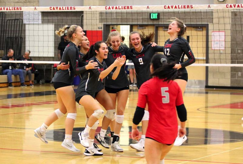 PMG PHOTO: JIM BESEDA - Clackamas volleyball players (left to right) Natalie Gwynn, Jaiden Eubanks, Hannah Adsitt, Lauren Livingstone, Kalista Lukovich, and Isabelle Combs celebrate after securing match point in Thursdays 25-20, 25-18, 25-22 home win over Sandy.