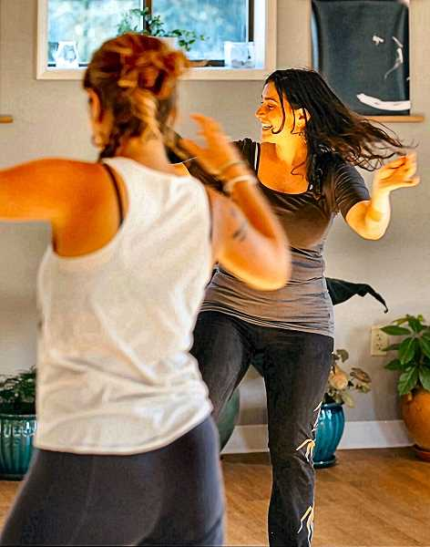COURTESY OF EMILY ROME - Emily Rome (in back), the Nia fitness instructor at the Woodstock Community Center, says, Finding joy in movement is the secret to fitness.
