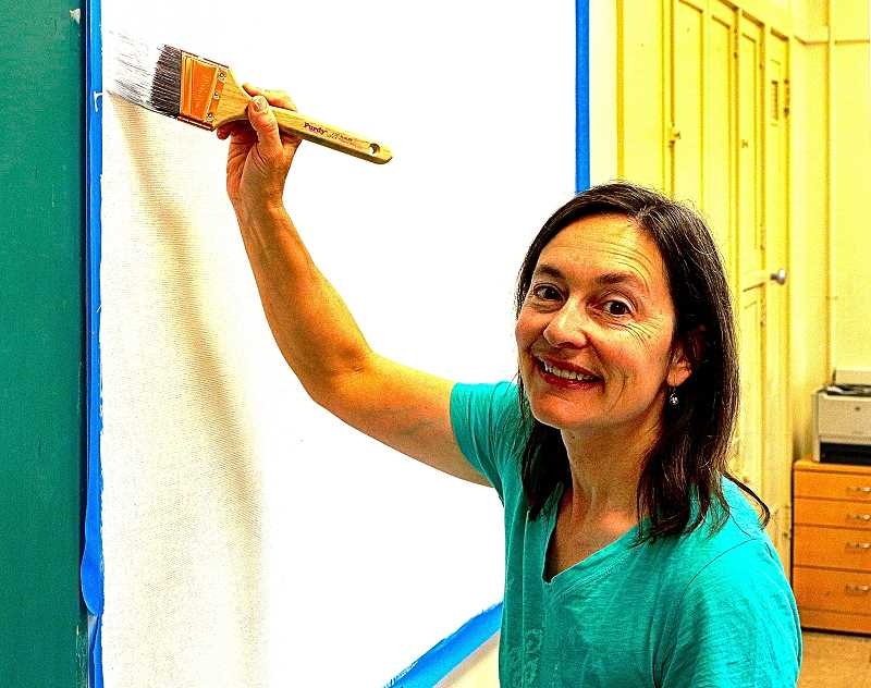 DAVID F. ASHTON - Inside Lane Middle School, volunteer Tanya Schaefer repainted a classroom whiteboard.