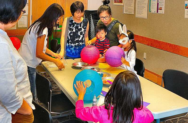 DAVID F. ASHTON - During the first part of the traditional Moon Festival at the Woodstock Library, kids were decorating Chinese lanterns.