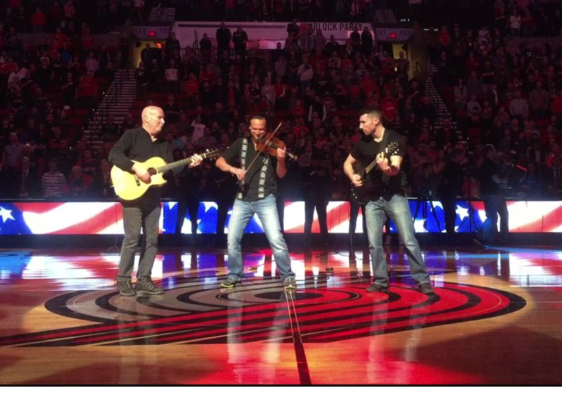 COURTESY PHOTO: TIFFANY ELLIS - In a scene from 'This is Tim: A Musical Life,' Tim Ellis (left) plays the national anthem at a 2016 Trail Blazers game with Aaron Meyer (middle) and son Tom Ellis (right).