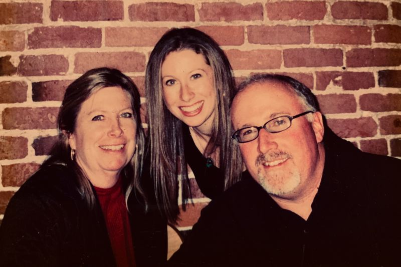 COURTESY PHOTO: TIFFANY ELLIS - Tiffany Ellis is flanked by her mother Susan and father Tim in an older photo.