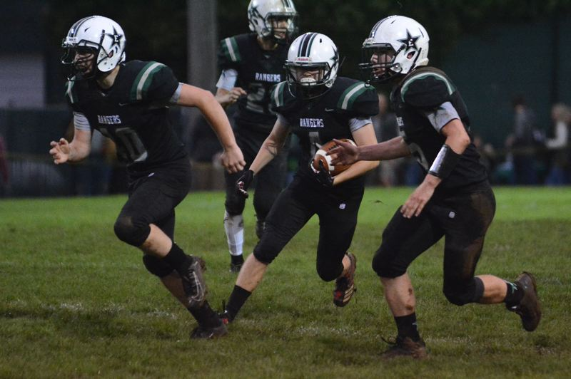 PMG PHOTO: DAVID BALL - Estacadas Garrett Shaver (4) follows his teammates across midfield after picking off a pass late in the first quarter of Fridays 40-13 win over Astoria.
