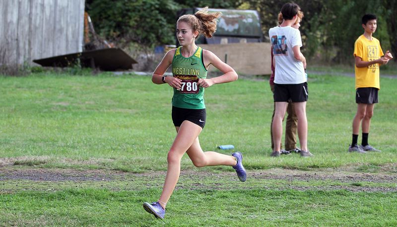 PMG PHOTO: MILES VANCE - West Linn sophomore Maddie Meyer heads for home during the Meriwether Cross Country Classic at Meriwether National Golf Course in Hillsboro on Friday, Sept. 20.
