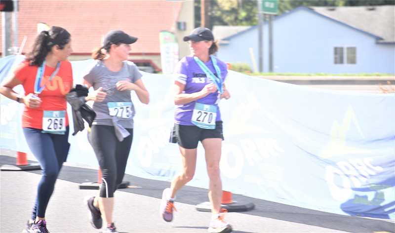 PMG PHOTO: EMILY LINDSTRAND - Athletes in the Best Dam Run traversed the Clackamas River and the River Mill Dam before making their way through downtown Estacada.