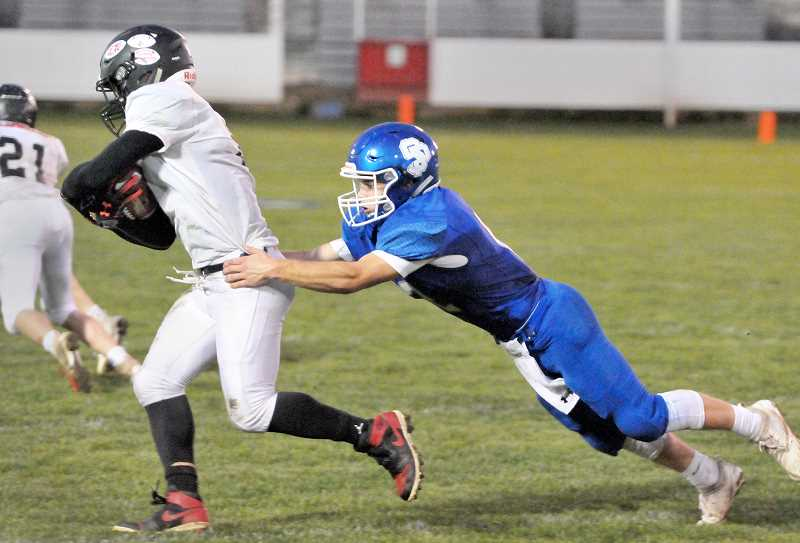 GRAPHIC PHOTO: GARY ALLEN - St. Paul's defense stymied Lowell for the much of the game Friday at home.