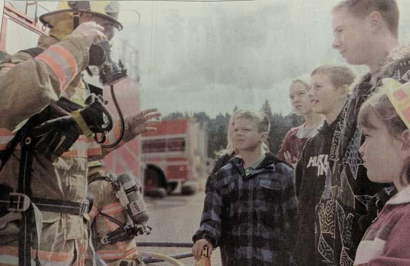 ARCHIVE PHOTO - In 2009, attendees of the Estacada Rural Fire Districts open house connected with members of the department.
