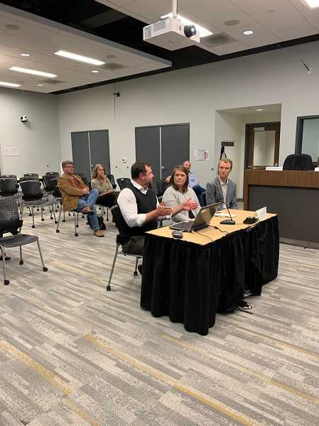 PMG PHOTO: CAROL ROSEN - Jon-Paul Bowles (left), Jamie Stickle and Calvin LeSueur discuss plans to increase tourism at the Sept. 18 City Council meeting.