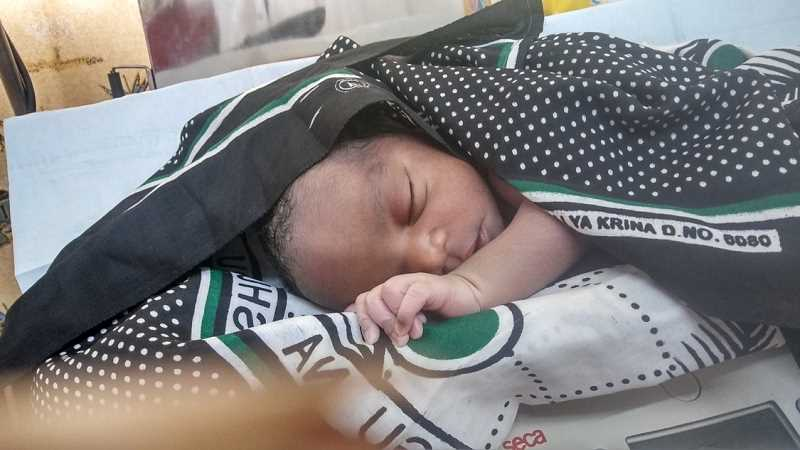 COURTESY OF GRACE KUTO - A newborn sleeps at the renovated clinic in Chwele, Kenya, this year.