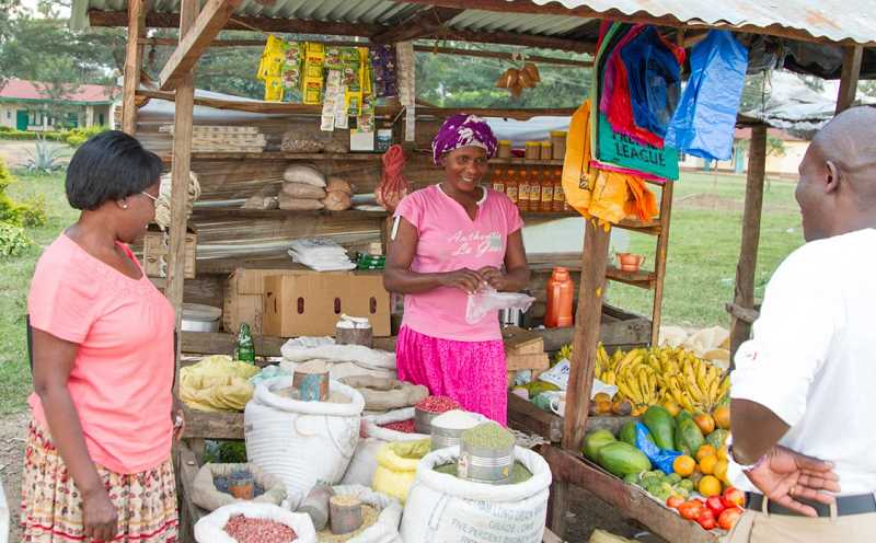 COURTESY OF GRACE KUTO - Grace Kuto,left, enjoys a recent trip through the market in Chwele, Kenya. She and her husband Paul sought funding for several years to purchase an ambulance for the village of Chwele, Kenya.