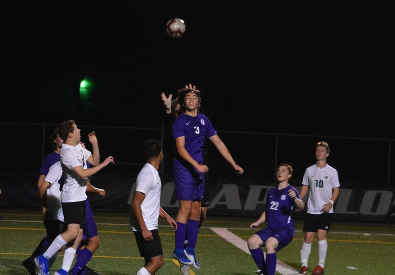 TIMES PHOTO: MATT SINGLEDECKER - Sunset midfieler Mason Norby goes up to head a ball against West Salem in non-league action.