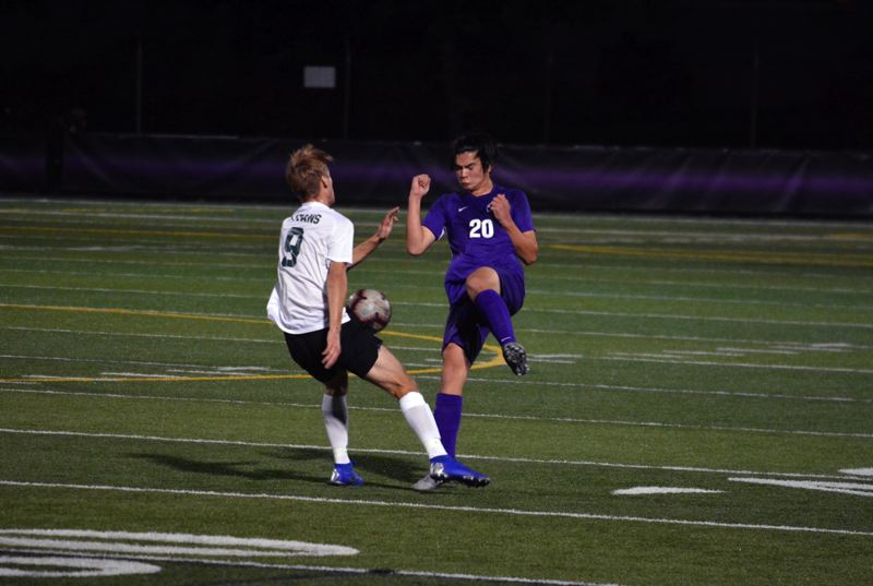 TIMES PHOTO: MATT SINGLEDECKER - Sunset defender Shinjiro Metzger tries to control a loose ball against West Salem in non-league action.