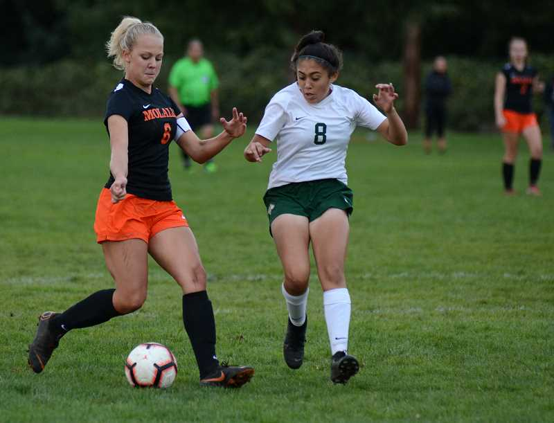 PMG PHOTO: DEREK WILEY - Molalla senior Madline Lisac scored the Indians first goal late in the first half of a 5-3 loss to North Marion Monday night.