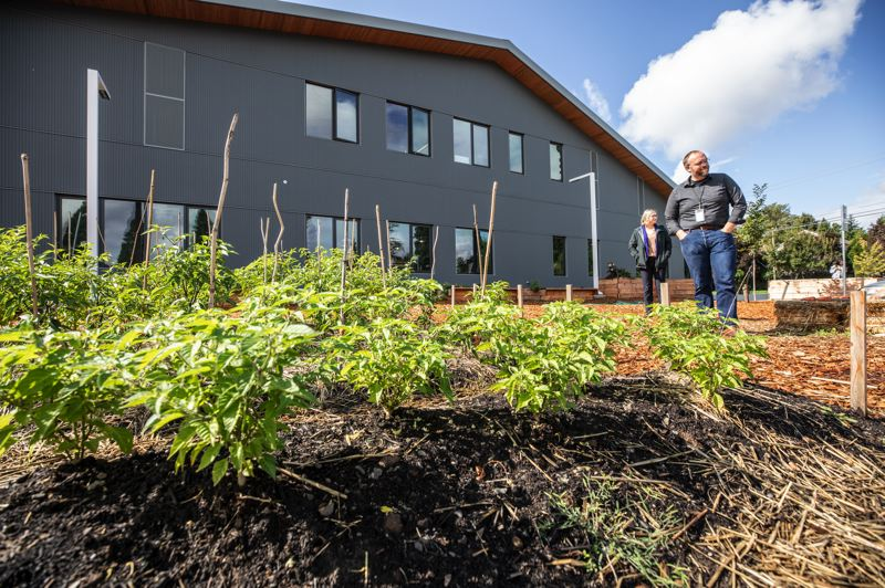 PMG PHOTO: JONATHAN HOUSE - Creekside Community High School principal Russ Romas stands along the school's learning garden.