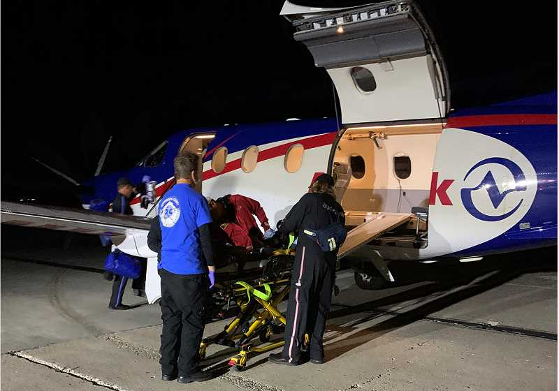 SUBMITTED PHOTO - Emergency personnel load Ezra onto a fixed-wing aircraft Friday night, to transport him to Doernbecher Children's Hospital late Friday night.