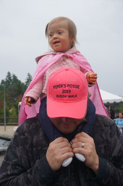 PMG PHOTO: CLAIRE HOLLEY - Piper Goodell with her father Shane at this years Buddy Walk at Millennium Park Plaza. Friends and family of the Goodells walked for Pipers Posse.