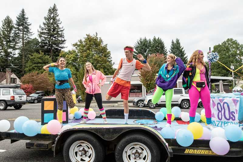 REVIEW PHOTO: JONATHAN HOUSE - Lakeridge students perform on an 80s-themed Jazzercise float during the Homecoming Parade.