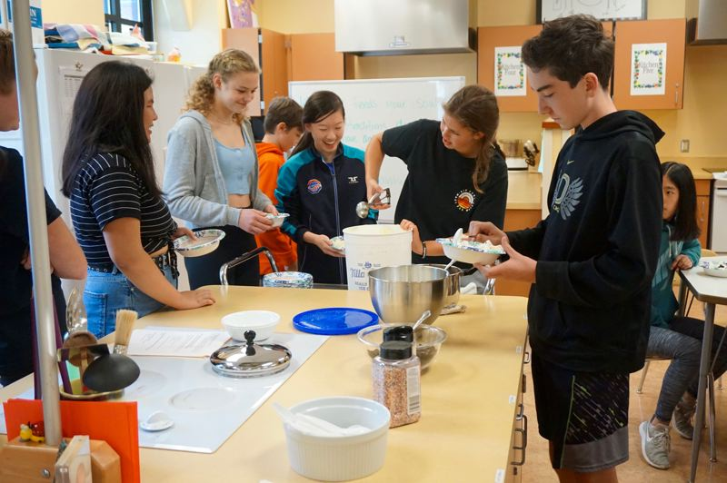 PMG PHOTO: CLAIRE HOLLEY - Lakeridge students prepare ice cream sundaes to eat while discussing food and culture at This Is Us Day.