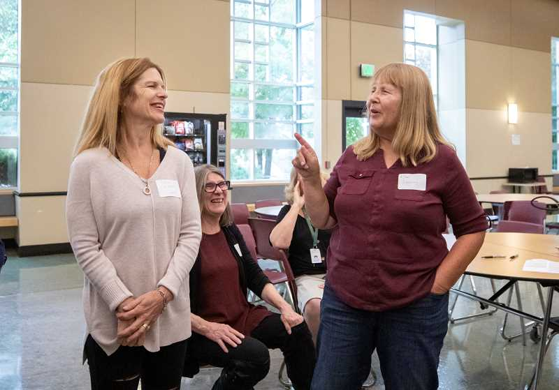 TIDINGS PHOTO: JONATHAN HOUSE - Sarah Colarchik, left, and Kim Leaming chat during a reunion tour of the West Linn Class of 74.