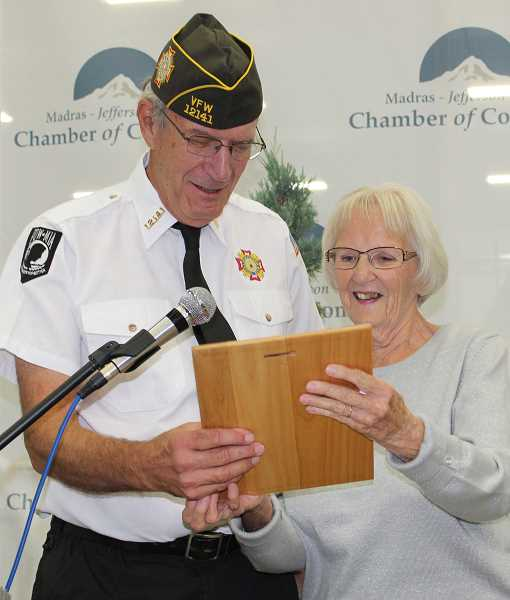 HOLLY M. GILL/MADRAS PIONEER - Richard Lohman is the recipient of the Community Champion award, presented by Louise Muir.