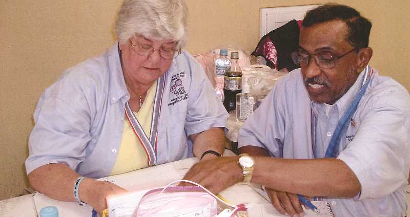 PHOTO COURTESY OF MARY REED - Mary Reed with Fellow Lions missionary Gerald Caldwell, collecting data at an eyeglass clinic site in Mazanilla, Mexico, in 2007.
