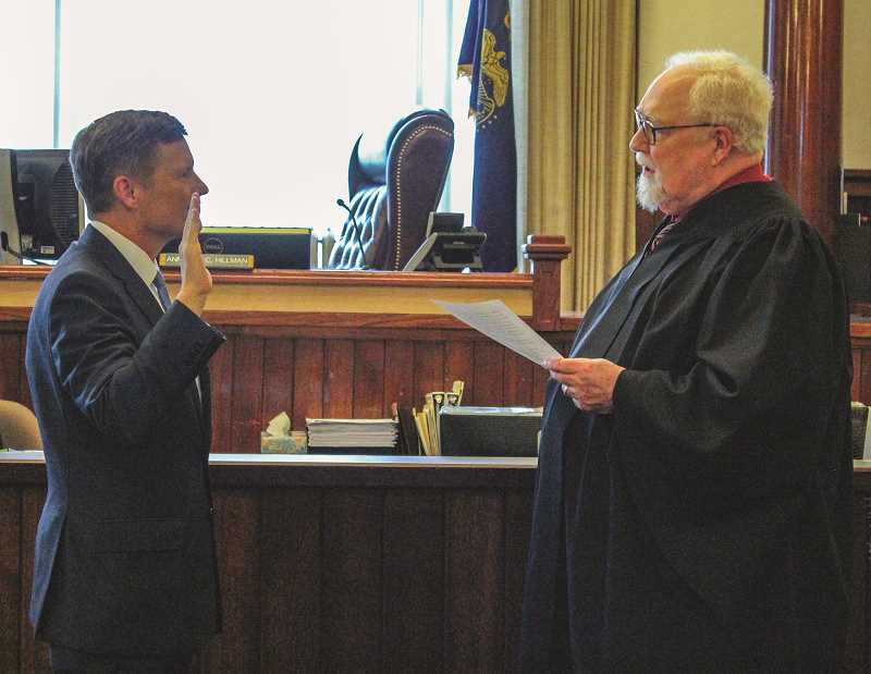 JASON CHANEY - Mike McLane takes the oath of office for circuit court judge during his investiture Friday afternoon from longtime friend and mentor, Michael Gillette, who is the senior judge on the Oregon Supreme Court.
