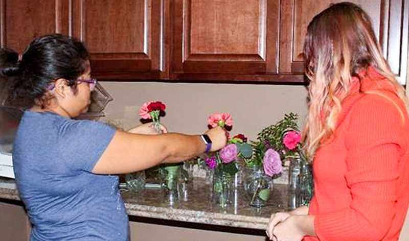 PHOTO COURTESY OF CROOK COUNTY SCHOOL DISTRICT - Transition students work on bouquets that will later be delivered to district employees.