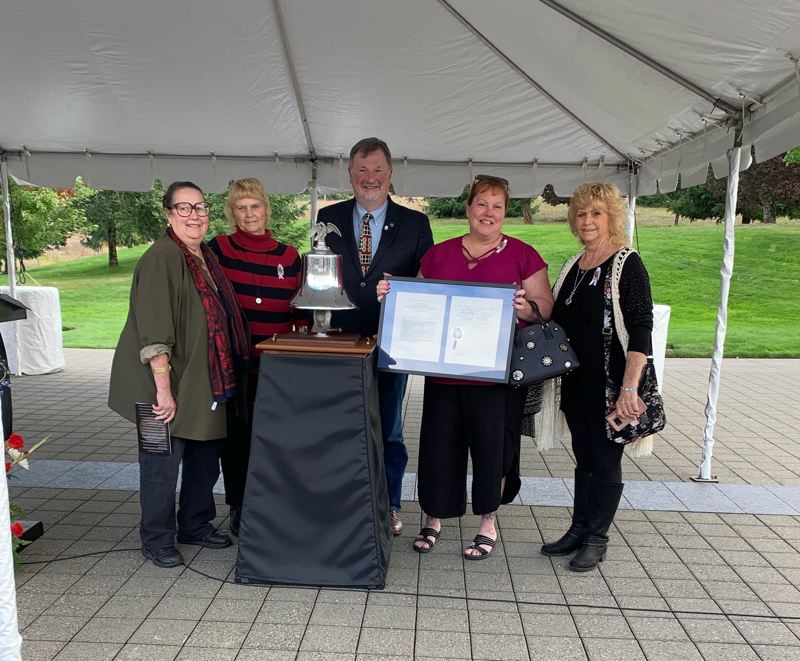 COURTESY PHOTO - Sen. Betsy Johnson, Evelyn Hudson, U.S. Rep. Brad Witt, Mary Hales and Eva Hudson pose for a photo following the Fallen Firefighters Memorial Ceremony in Salem on Thursday, Sept. 19. Johnson presented Hales with a signed copy of a bill that was passed in the 2019 legislative session to allow the names of fallen firefighters to be included on roadside memorials.