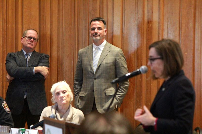 OREGON CAPITAL BUREAU: SAM STITES - Matt Donegan, center, listens as Gov. Kate Brown addresses the Governor's Council on Wildfire Response after hearing a presentation on the council's pending recommendations.