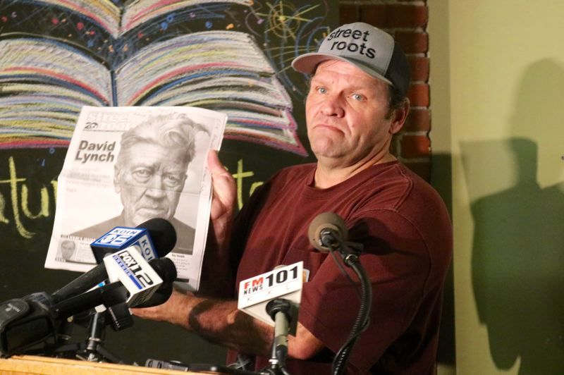 PMG PHOTO: ZANE SPARLING - Street Roots vendor Dan Newth holds up a recent edition of the newspaper.