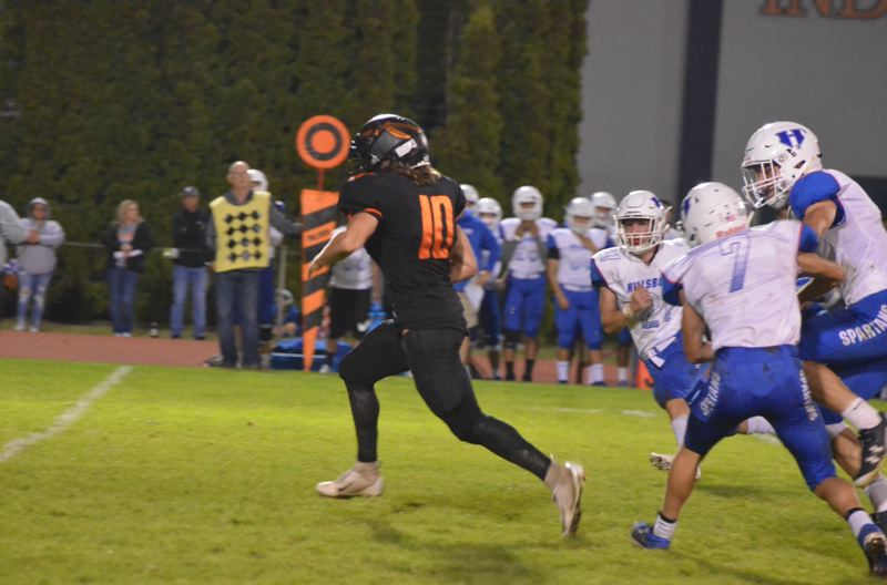 COURTESY PHOTO: JOHN BREWINGTON - Connor Maclachlan hit the hole quickly and was off to the races, leaving Hillsboro defenders in pursuit on a touchdown run that helped turn the tide Scappoose;s way at home last week.