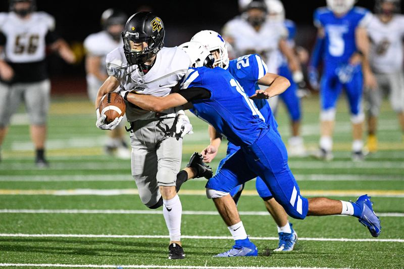 PMG PHOTO: CHRISTOPHER OERTELL - Hayden Bigham was one of the receivers who helped the St. Helens click on some key pass plays in Week 3 of the high school football season.