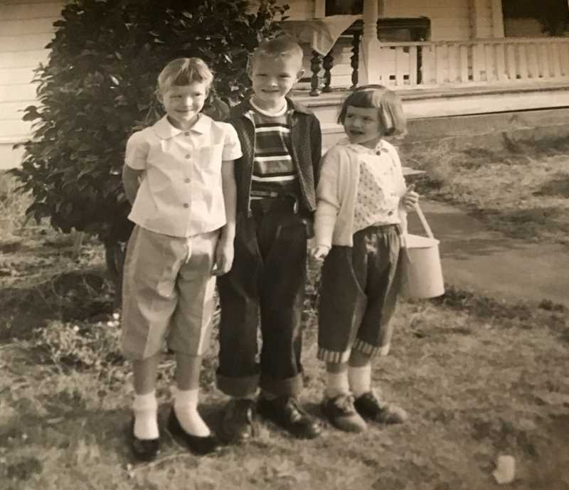 COURTESY PHOTO: SHEILA DANIELS - Sheila Daniels (left) stands with her brother Gary Peterson (center) and younger sister Karen Peterson on Gary's first day of school.
