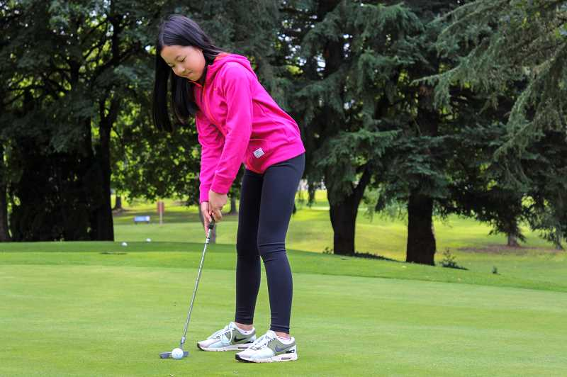 PMG PHOTO: CLARA HOWELL  - Kate Ly, 11, will advance to the National PGA Drive, Chip and Putt Competition next April in Georgia.