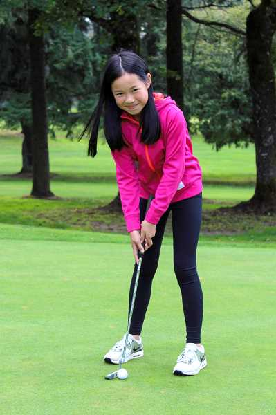 PMG PHOTO: CLARA HOWELL - Kate Ly, 11, started taking golf more seriously a couple years ago and plays in about 15 tournaments a year.