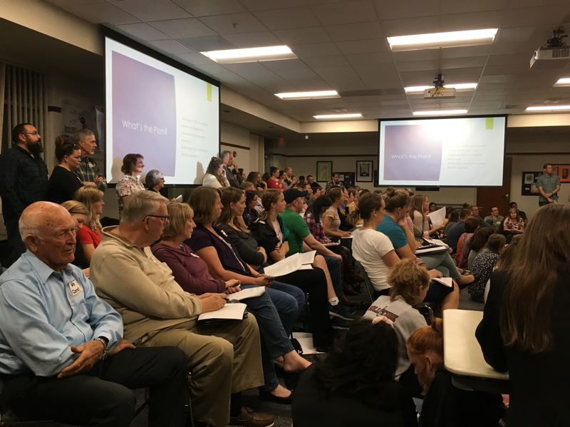 PMG PHOTO: MAX EGENER - About 100 people filled the room at the Hillsboro School District board meeting Tuesday, Sept. 24. They came to urge the district not to adopt a new comprehensive sexuality education plan.