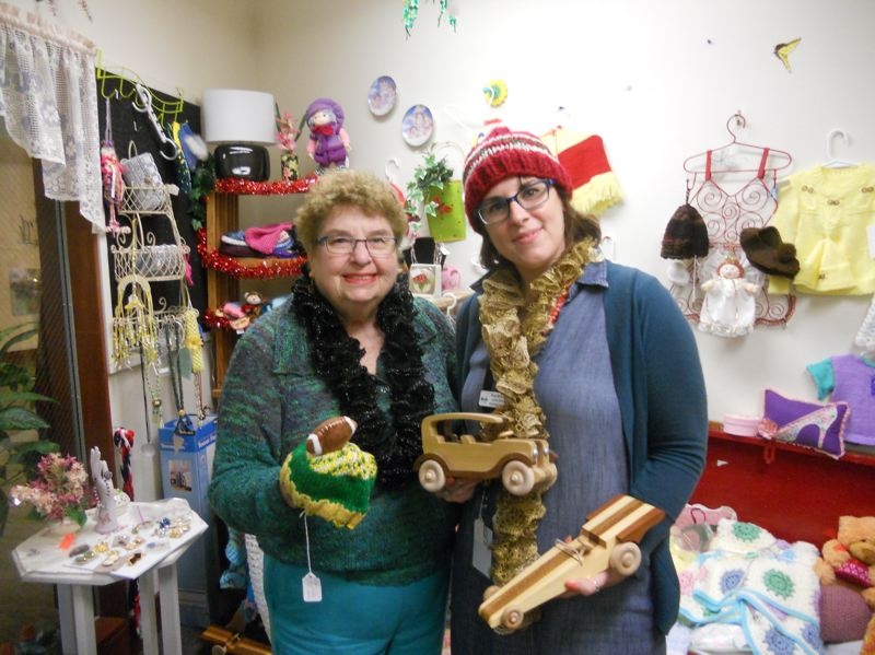 PMG PHOTO: SCOTT KEITH - Marjorie Stewart Senior Community Center manager Maiya Martin Burbank (right) and Anne Poe show off wares in the Butterfly Boutique.