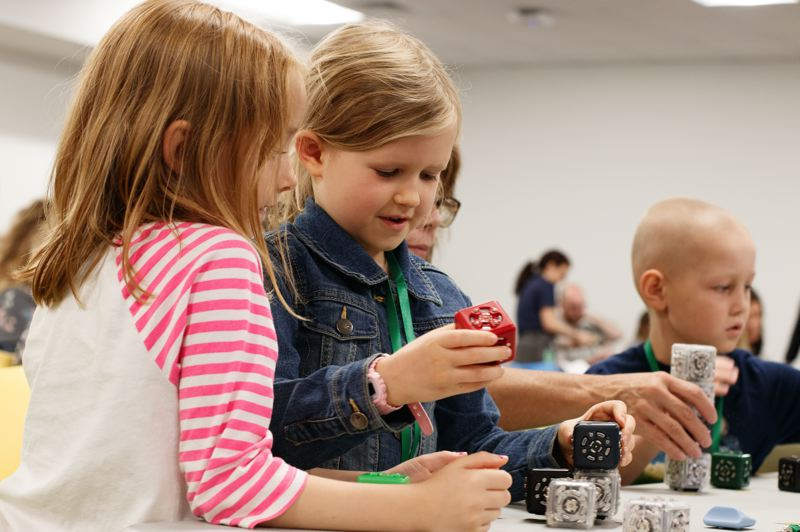 COURTESY PHOTO: AMAZON FULFILLMENT CENTER  - Children from the Doernbecher Pediatric Cancer department participate in Camp Amazon, a series of STEM activities at the PDX9 Robotic Fulfillment Center in Troutdale OR.