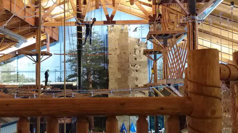 PMG PHOTO: RAY PITZ - Langers: Since 1879 Entertainment Center features an elaborate ropes course that is on two levels. The complex opened on Friday.
