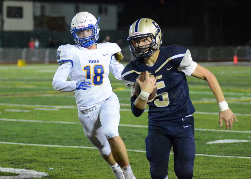 PMG PHOTO: DEREK WILEY - Canby sophomore Mikey Gibson rushed and threw for a touchdown in the fourth quarter of the Cougars' 40-14 loss to Newberg Friday.