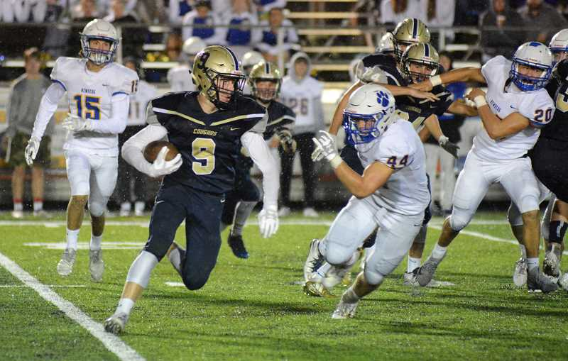 PMG PHOTO: DEREK WILEY - Canby junior Tyler Mead returns a kickoff in the second half Friday against Newberg.