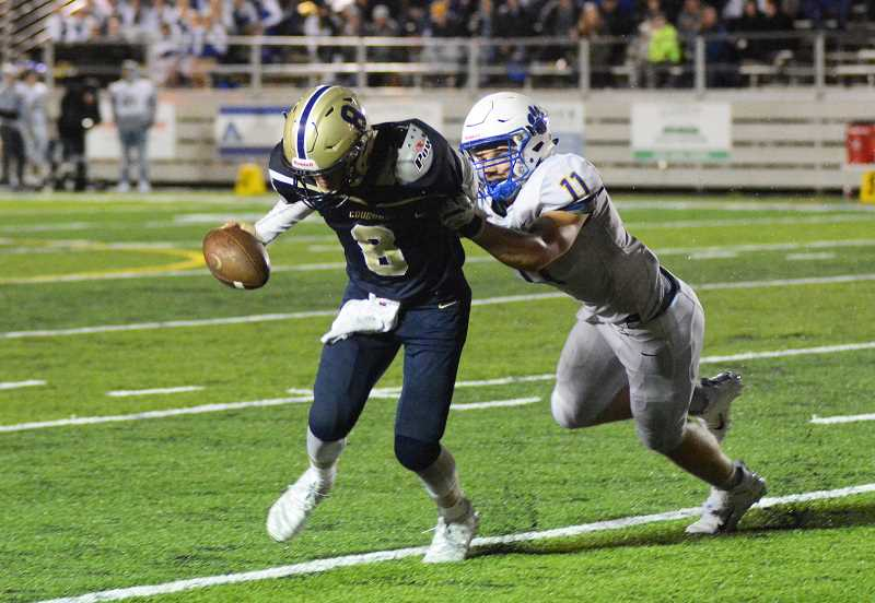 PMG PHOTO: DEREK WILEY - Canby senior Andrew Peters is sacked by Newberg linebacker Jared LaPointe in the third quarter.