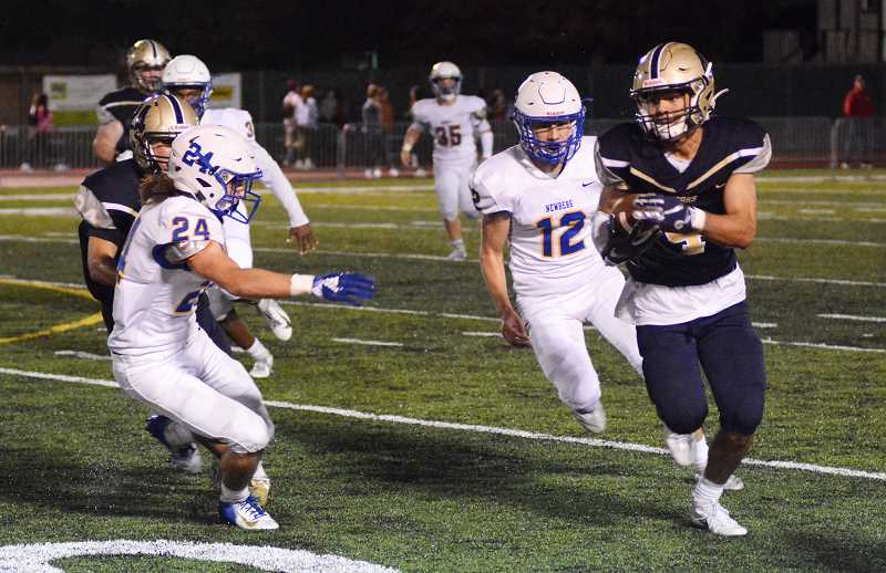 PMG PHOTO: DEREK WILEY - Canby senior Ronan Gay took a screen pass 57 yards for a touchdown in the fourth quarter Friday.