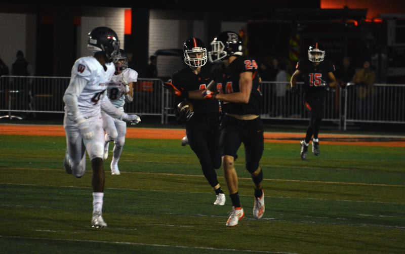 TIMES PHOTO: MATT SINGLEDECKER - Beaverton junior Trent Walker had two touchdown catches, a pick-six and a succesful two-point pass in the first half against Westview.