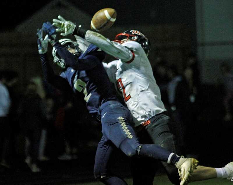 PMG PHOTO: WADE EVANSON - Banks' Jarred Evans fights with Tillamook's Kellen Shelley for a pass reception during the Braves' game against the Cheesemakers Friday, Sept. 27, at Banks High School.