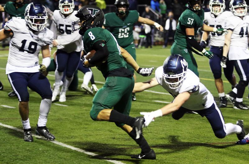 PMG PHOTO: DAN BROOD - Tigard High School senior Josh Burns gets into the end zone on a 3-yard scoring run during the third quarter of the Tigers' 31-7 win over Lake Oswego.